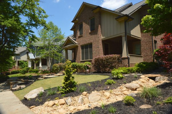 front yard with stone landscape water drainage design