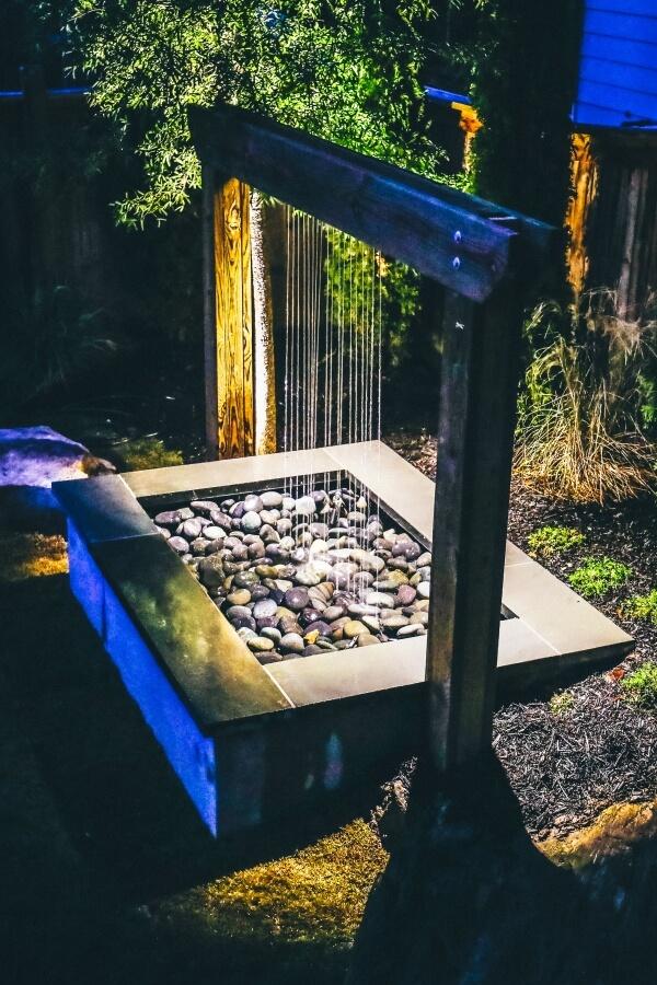 backyard water fall with modern stone design
