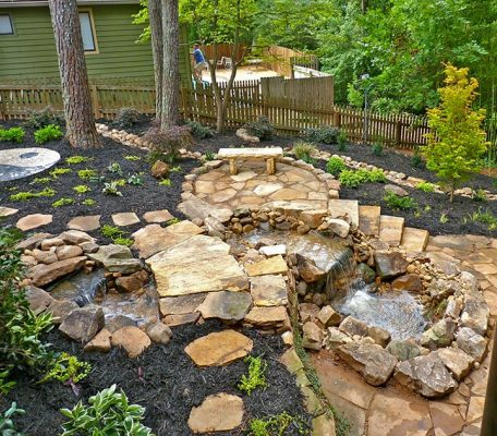 stone hardscaping with garden fountain water fall feature