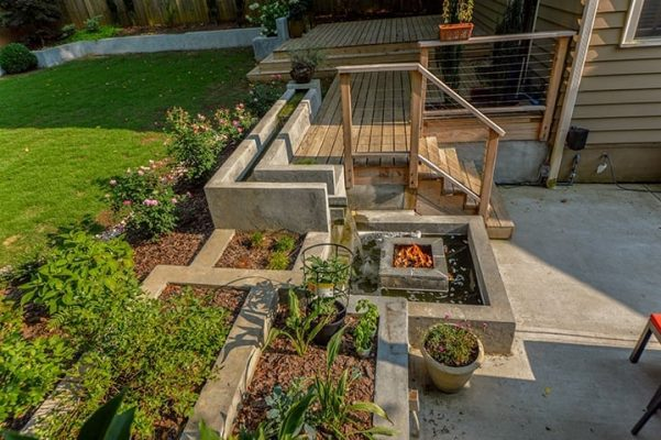 backyard patio and fire feature hardscaping with outdoor gardening