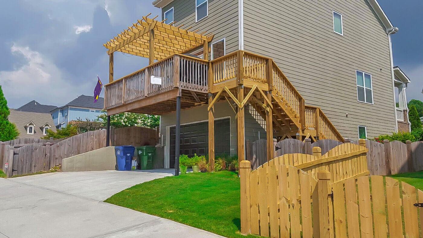 wood deck with pergola over backyard home garage