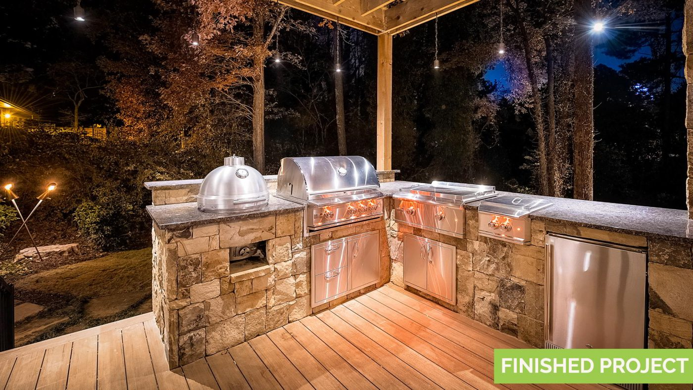 outdoor backyard kitchen with stainless steel appliances