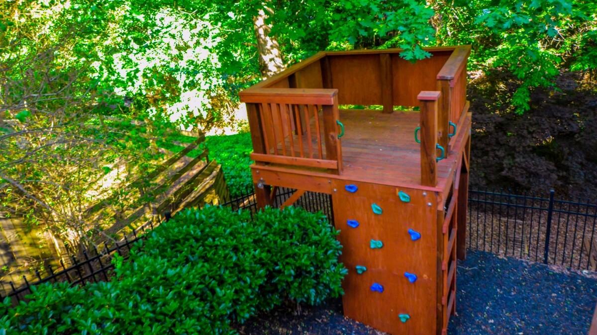 backyard playground with rock climbing wall