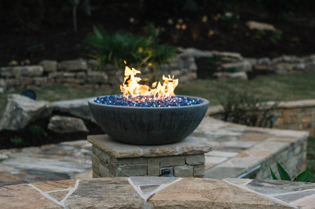 backyard firebowl on stone hardscape