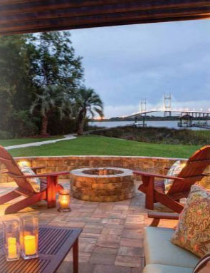 backyard living space and fire pit with scenic view of bridge