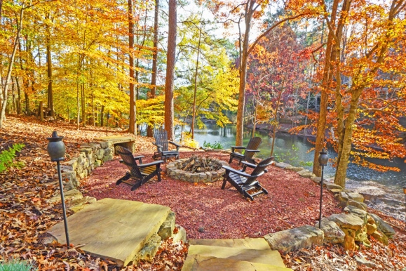 fire pit next to atlanta river in autumn